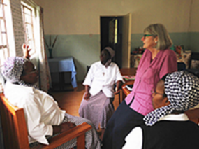 Catherine with the Daughters of the Redeemer in Zambia, on a UISG and GHR Foundation project